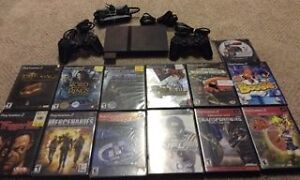 Playstation 2 Slim with 2 Controllers and 13 Games!