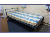 Metal single bed with mattress for sale