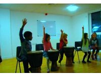 Affordable children's music classes in Greenwich for 6-10 year olds. Piano, guitar, drum kit lessons