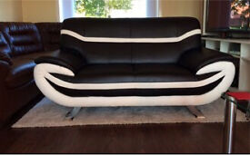 Black and white leather sofa can deliver