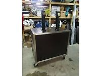 Mobile Bar with Dispense System on Wheels with Tower Taps on it