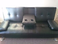 black faux leather sofa bed, futon, with drink holder and pillows, CAN DELIVER