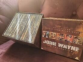 full collection of john Wayne DVDs thirty four classic john Wayne movies never been used