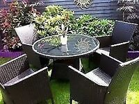 heavy rattan patio set 4 carver chairs,round glass table-rarely used & umbrella parasol
