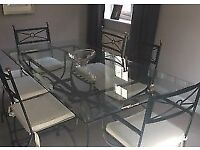 Wrought iron table with 6 chairs