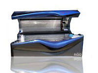 Two Ergoline Avantgarde 600 classic sunbeds for sale.