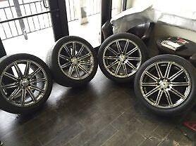 4 mags Ruffino chromees pour BMW X5 Avec Pneus Nitto ÉTÉ 1450$
