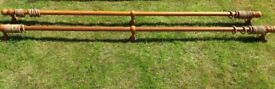 Two wooden curtain poles with rings