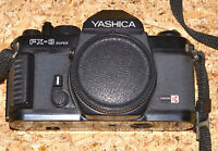 Yashica FS-300 Super Camera And 3 Lenses, Flash, Cleaning Kit