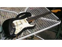 Stolen fender stratocaster black with White scratchplate covered in stickers
