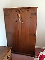 Oak wardrobe made by Wood brothers abot 1950, carved doors ..