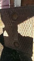 2x cast iron manhole covers with frames