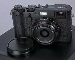X100F LNIB with lots of accessories