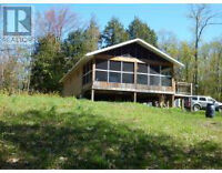 Cottage with 25 acres on year round road