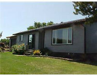 Beautiful 5.21 acres, 3 houses, 3 outbuildings - one price!