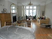 Large Bed-sitting room in a Stunning and Beautiful home near Bus garage. Internet and Bills included