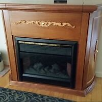 Nice fireplace and bar cabinet