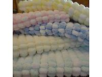 Hand knitted beautiful soft baby pram blankets in Rico pom pom wool