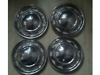 "CLASSIC MINI WHEEL COVERS 10"" USED."