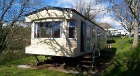 Static caravan for sale on Devon Bay holiday park. Pet friendly 11 month site, close to the beach.
