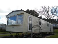 Cheap 4 bedroom holiday home for sale £25,995 inc fees and insurance. Short walk to beach. S.Devon