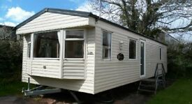 cheap Static holiday home. Site fees included. Caravan on devon bay park. Paignton, Torbay area.