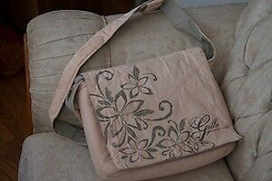 One Leather And Two Canvas Laptop Bags