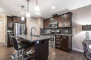 QUICK POSSESSION! LOADED DUPLEX IN SHERWOOD PARK! DOUBLE GARAGE!