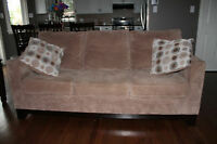 Beige matching loveseat and Sofa