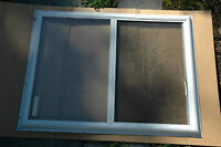 Metal storm window w/ screen -- in excellent condition