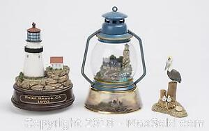 Two Lighthouse Music Boxes with Pelican Decor