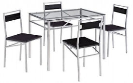 Dining table, set, with 4 chairs, full set.new flat packed, tampered glass top. boxed.