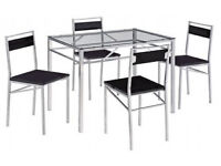 Dining table, set, with 4 chairs, full set.new flat packed, tampered glass top.