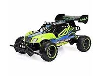 RC Intruder Buggy. Custom Green with thick tyres, suspension.