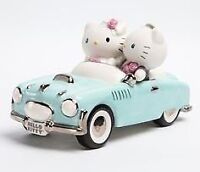 Two Hello Kitty figurines