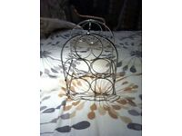 Chrome wine rack, holds 5 bottles of wine, good condition and from pet and smoke free home