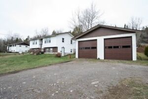 Spacious 3 BRDS home, dtached garage w/ commercial sized door!