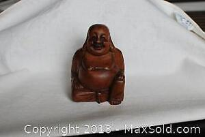 """Wood carved """"Laughing Buddha"""" statue."""