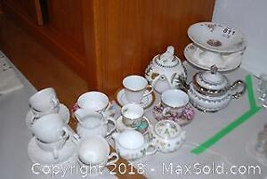 Teapots, Cups And Saucers A