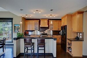 Maple Kitchen Cabinets and Corian Countertops