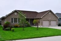 CUSTOM BUILT STONE BUNGALOW IN NEWER SUBDIVISION