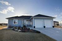 Newer 5 Bedroom Home in Ste. Agathe with 2 Garages!