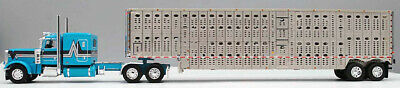 DCP FIRST GEAR 1/64 SCALE 389 PETERBILT FLAT TOP TEAL LIVESTOCK TRAILER #60-0813 1