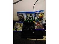 PS4 with 4 games, 2 controllers and all cables