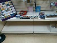 All stock shelving and card stands must be sold