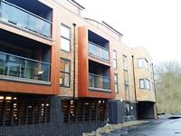 Central top floor unfurnished 1 bedroomed apartment with 2 balconies and undercroft parking space