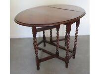 Gate-legged dining table with barley sugar twist legs