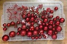 Assorted red Christmas tree decorations including wooden ones