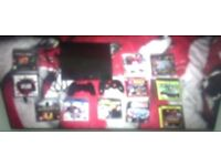 PS3 with 10 games, 2 controllers and a bluetooth in-ear mic!