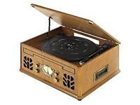 Brand new, boxed, ITEK Nostalgic Music System. Never used record player, cassette, CD Player.